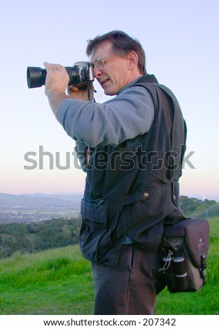 Male photographer overlooking valley