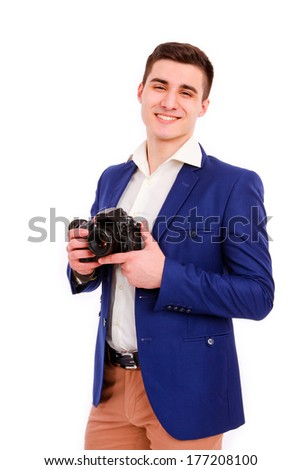 Male photographer with his camera isolated on the white background - stock photo