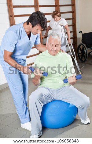 Male Physical therapist helping a patient. - stock photo