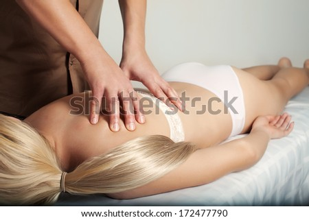 Male physiotherapist doing adjustment - stock photo