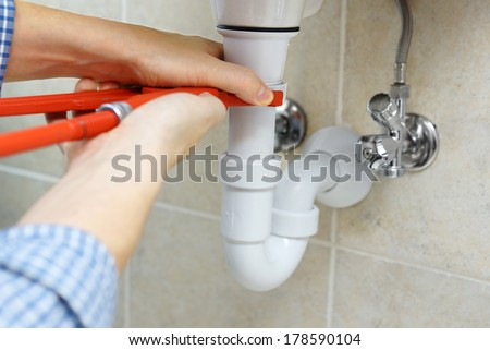 male plumber fixing flood - stock photo