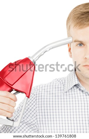 Male pointing red color fuel pump nozzle at his head - stock photo