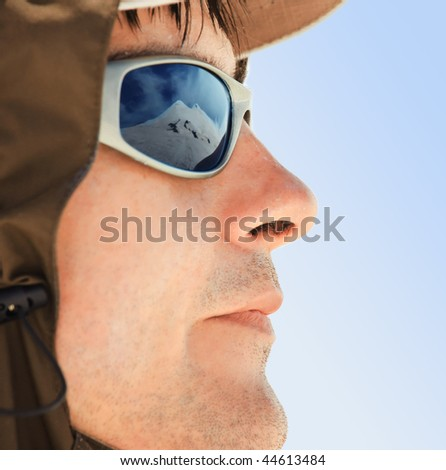 Male portrait on blue sky background - stock photo