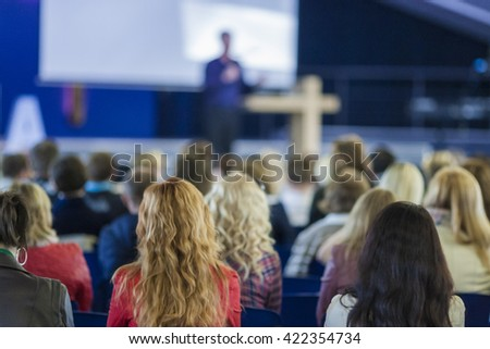Male Professional Lecturer Speaking In front of the Group of People. Horizontal Image Composition. Horizontal Composition - stock photo