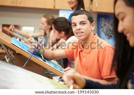 Male Pupil In High School Art Class - stock photo