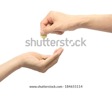 male putting coin  in a safety male hand - stock photo