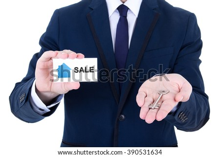 male real estate agent hands with key and visiting card isolated on white background - stock photo