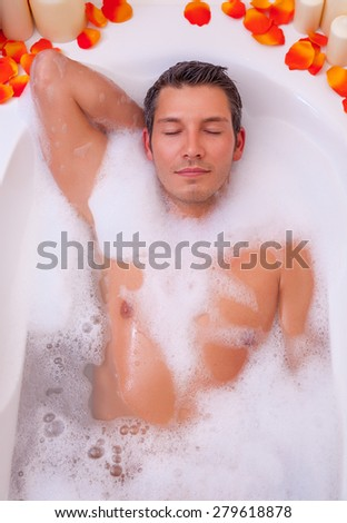 male relaxing in bathtube after hard day - stock photo