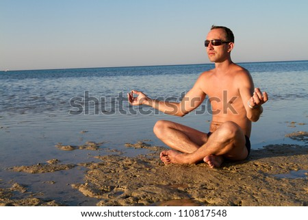 male relaxing on coast growing success balance