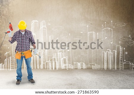 Male repairman holding drill machine and hammer against hand drawn city plan - stock photo