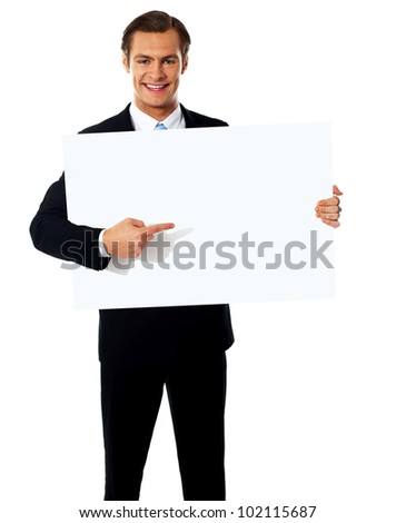 Male representative pointing towards placard, isolated on white