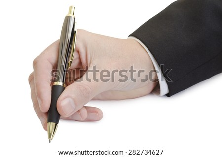 Male right hand holding ballpoint pen in a writing position. Pen has dark rubber grip, shiny brown and golden parts. Sleeve of white shirt and dark suit can be seen on arm above wrist. Isolated image.