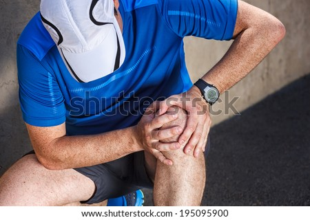 Male runner having problems in knee joint. - stock photo