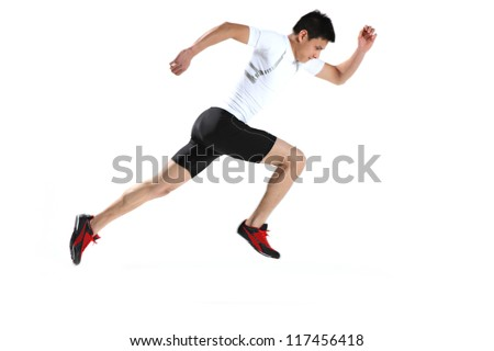 Male runner in starting blocks - stock photo
