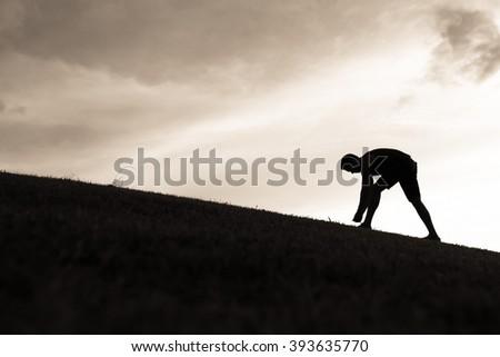 Male runner tying his shoe.  - stock photo