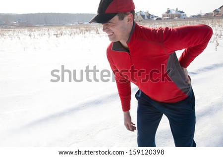 Male runner was injured during training - stock photo