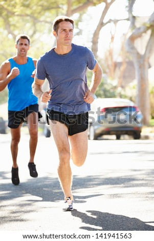 Male Runners Exercising On Suburban Street