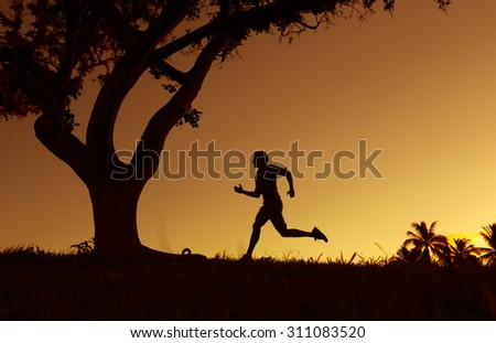Male running in the park.  - stock photo