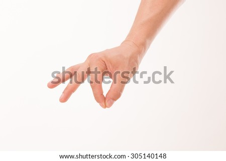 Male's hand picking up something isolated on white background. All man's fingers are every which way. - stock photo