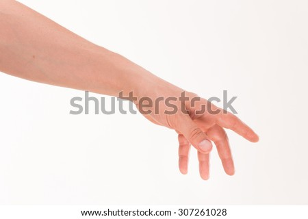 Male's hand trying to reach something and take it. Confident man's hand and his arm know what to do. - stock photo