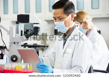 Male Scientist Using Tablet Computer In Laboratory
