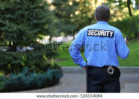 Male security guard protects house