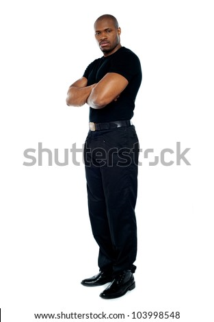 Male security guard with strong arms crossed on white background - stock photo