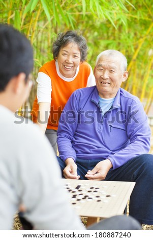 """male seniors win a chinese board game .""""weiqi"""" - stock photo"""