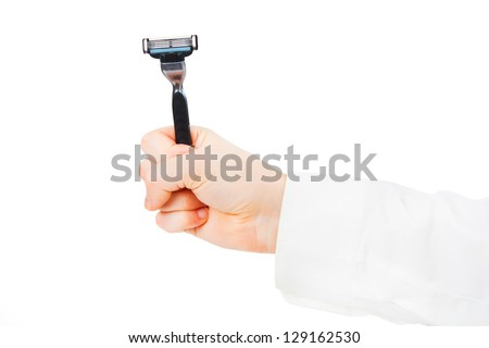 Male shaver in hands fist - stock photo