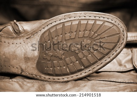 Male shoe sole. Handmade shoes. Vintage style. Cowboy style. Autumn and spring shoes. Photo toning in sepia - stock photo