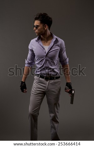 Male shooter or contractor with handgun, looking right - stock photo