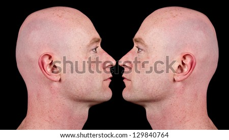 male side profile close up head shot. two male man shaved head bald profile. close up shaved face. isolated on black background.