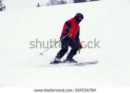male skier on downhill a steep hill