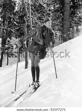 Male skier skiing downhill - stock photo