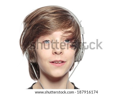 male smiling teenager with headphones, isolated on white. - stock photo