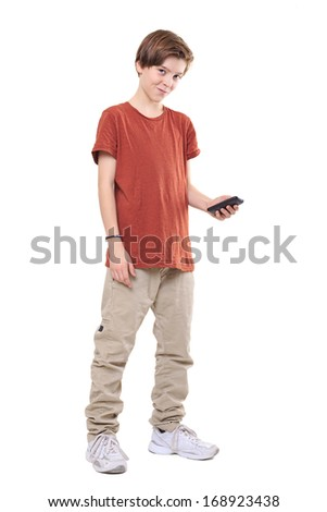 male smiling teenager with mobile phone, isolated on white. - stock photo