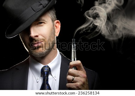 male smoking a vapor cigarette as an alternative to tobacco - stock photo