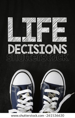 Male sneakers with life decisions. Male sneakers with life decisions on the back background - stock photo