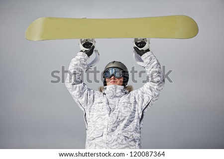 male snowboarder against sun and blue sky - stock photo