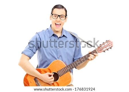 Male street musician playing guitar isolated on white background - stock photo