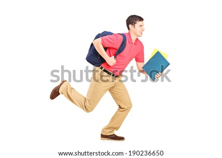 Male student holding books and running isolated on white background
