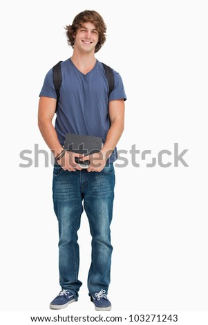 Male student posing with a backpack and books against white background