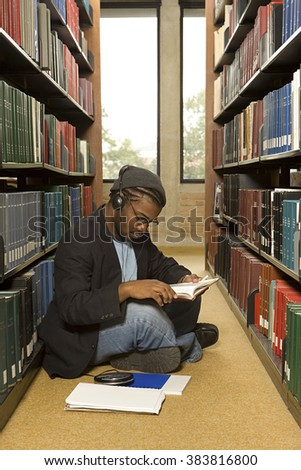 Male student reading in the library