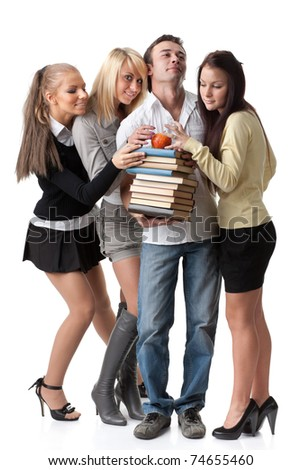Male student with books and an apple among beautiful female students. - stock photo