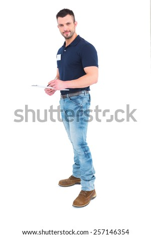 Male supervisor writing on clipboard over white background - stock photo