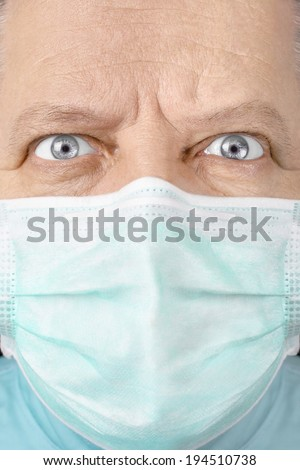 Male surgeon looking seriously close up - stock photo