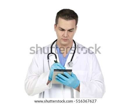 Male surgeon review notes prior to surgery