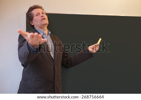 Male teacher calling on student to answer a question  - stock photo