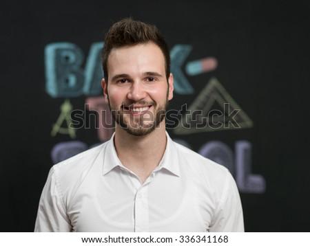 Male Teacher in his classroom - stock photo