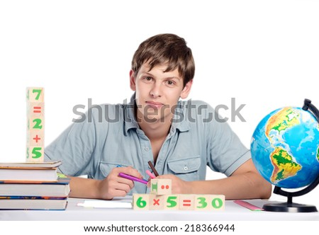 male teacher with books and a globe of the earth - stock photo